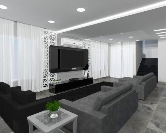Ampla sala, com projeto moderno baseado nas cores preto, branco e suas tonalidades.